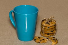 A Cup of tea and biscuits on on background burlap Royalty Free Stock Images