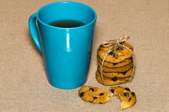 A Cup of tea and biscuits on on background burlap Royalty Free Stock Photo
