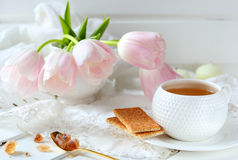 Cup of tea, biscuits and caramel sugar Stock Photo