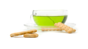 A cup of tea and biscuits (focus on biscuits) Stock Photos