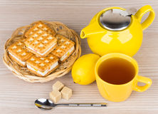 Cup of tea, biscuits, lemon and lumpy sugar Royalty Free Stock Photo
