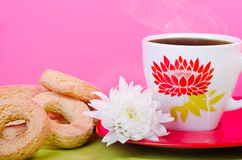Cup of tea with biscuits and a lovely flower Stock Photos
