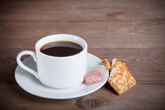 Cup of tea with biscuits and marmalade on old wooden table Royalty Free Stock Photos