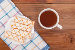 Cup of tea biscuits in a plate Stock Images