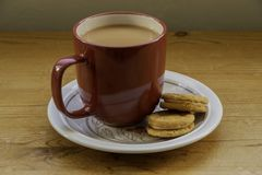 A cup tea and biscuits. stock images