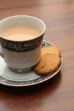 A cup of tea with biscuits Stock Photo