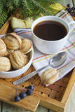 Cup of tea and biscuits. On the table Stock Images