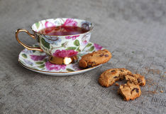 Cup of tea with biscuits on table cloth Royalty Free Stock Photos