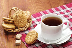 Cup of tea with biscuits Stock Photos