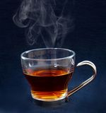 Cup of tea. On black background Stock Image