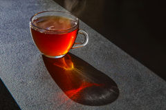 Cup of tea on black background kitchen. Mug of warm tea on Backgrund black table royalty free stock photography