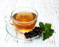 Cup of tea and black currant Stock Photo