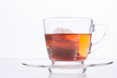 Cup of tea. Black tea in glass cup. Isolated on white background Royalty Free Stock Images
