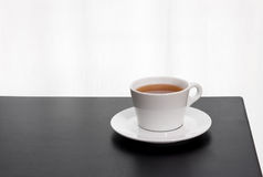 Cup of tea on a black table Royalty Free Stock Image