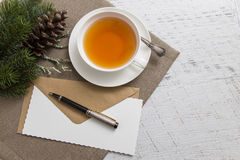 Cup of tea with blank empty paper sheet and Christmas decoration Royalty Free Stock Images