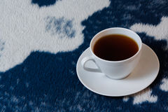 Cup of tea on the blanket Stock Image