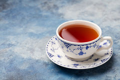 Cup of tea on a blue stone background. Copy space Stock Image