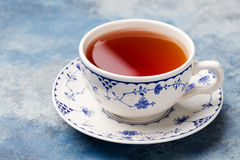 Cup of tea on a blue stone background. Copy space Stock Images