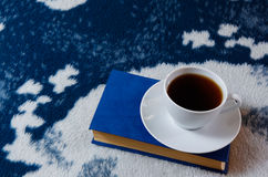 Cup of tea and book on the blanket Stock Images