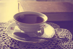 Cup of tea with book on napkin vintage effect Royalty Free Stock Photo