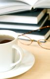 Cup of tea, books and eyeglasses Stock Photography