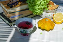 Cup Of Tea And Books And Pumpkins