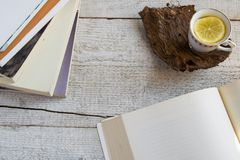 Cup of tea and books on wooden background with space for text. Concepts -  relaxing time spent at home, rustic hygge life. Studying Stock Photography