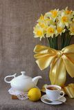 A cup of tea and a bouquet Stock Images