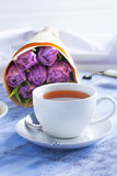 Cup of tea and bouquet of tulips in the morning. Royalty Free Stock Photos
