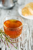 Cup of tea and branch of heather Royalty Free Stock Photos