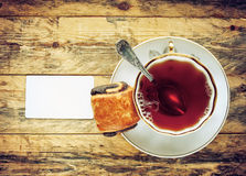 Cup of tea and bread roll Royalty Free Stock Photos