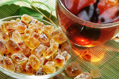 A cup of tea and brown sugar Royalty Free Stock Photos