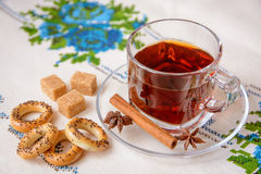 Cup of tea with brown sugar, anise, cinnamon and bagels Stock Image