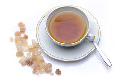 A cup of tea with brown sugar Stock Image