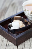 Cup of tea with brown sugar Royalty Free Stock Photos