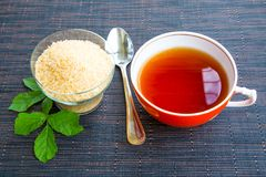 Cup of tea and brown sugar Royalty Free Stock Photos