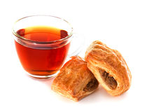 Cup of tea with bun Royalty Free Stock Image