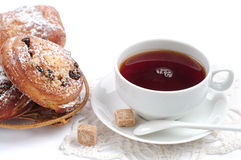 Cup of tea and buns with raisins Stock Image