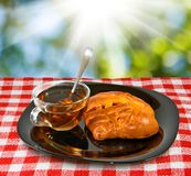 Cup of tea and buns on a table against the sun Royalty Free Stock Photography