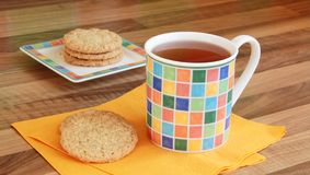 Cup of tea with a butter biscuits. Cup of tea with whole grain butter biscuits Stock Images