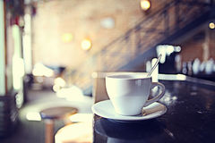 Cup of tea at a cafe. Blurred background royalty free stock photo