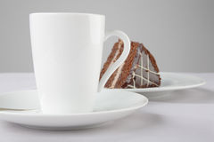 A cup of tea and cake. A cup of tea and piece of cake royalty free stock photos