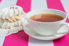 Cup of tea with cake. Cup of tea and airy cake of meringue with cream royalty free stock image