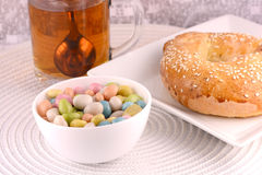 A cup of tea with a cake and candies Stock Photo