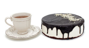 Cup of tea and cake with chocolate icing Royalty Free Stock Images
