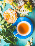 Cup of tea with cake and flowers. Summer tea time Royalty Free Stock Images