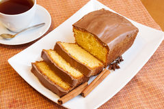Cup of tea and cake with glaze of chocolate and spices Royalty Free Stock Photography