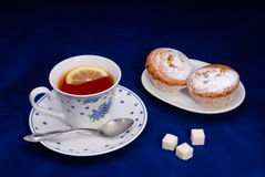 Cup of tea with cake Royalty Free Stock Image