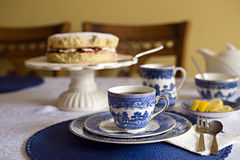 Cup of tea and a cake. Sponge cake and cup of tea on the table royalty free stock images
