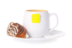 A cup of tea with a cake Stock Photography